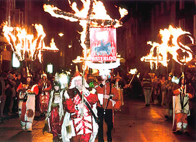 Waterloo Bonfire Society's pioneers processing through the streets of Lewes 